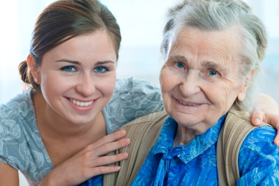 elderly woman and female caretaker